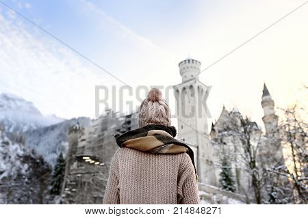 Young Woman Looking On Famous Royal Castle Neuschwanstein In Winter Day