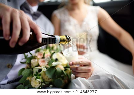 Groom And Bride Drinking Sparkling Wine During Celebration Their Wedding Day