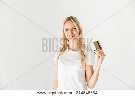 beautiful young woman holding credit card and smiling at camera