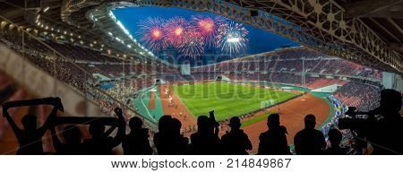 The silhouette of fan club over the panorama of Abstract blurred photo of fan sport at stadium with firework sport background concept