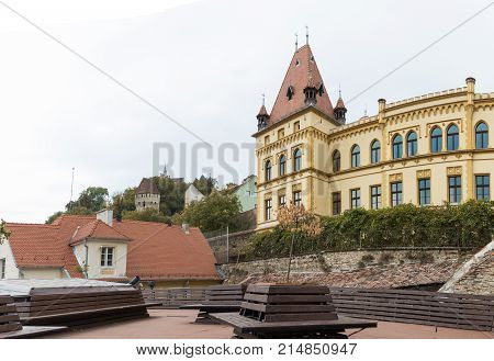 Fragment of the palace adjoining the clock tower in old city of Sighisoara in Romania