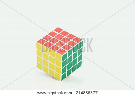Bangkok, Thailand - November 11, 2017: Rubik's cube 44 is difficult for play but good for brain on a white background. Rubik's Cube invented by a Hungarian architect Erno Rubik in 1974.
