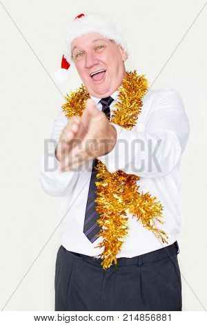 Excited happy businessman in Santa hat applauding and looking at camera. Joyful emotional male employee congratulating colleague and clapping hands. Greeting concept