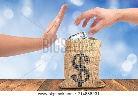 A theft money concept, A hand theft money from sack bag with dollar sign, corruption concept