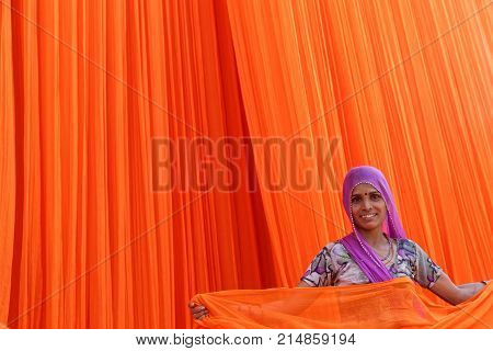 PALI INDIA November 3 2017 : Woman in textile factory. Pali is famous for its textile industries. This is the biggest cotton mill of Rajasthan it employs 3000 workers.