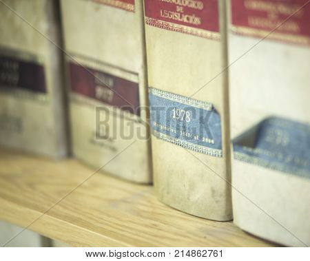 Law firm offices old legal report books on bookshelf. The book models are old and generic and do not require property release. poster