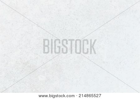Rough white plaster on grey wall. Light background perfect as backdrop for your text and other design elements. Rustic, vintage style. Peeling plaster on gray surface. Horizontal location.