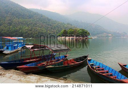 Boats at the Phewa lake in Pokhara Nepal