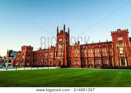 Belfast UK. The Lanyon Building Queen's University Belfast Northern Ireland UK in the evening with cloudless blue sky