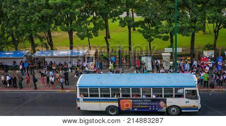 Chatuchak park, Bangkok,Thailand 10 Nov 2017 : People wait for bus at bus stop in front of Chatuchak park.  Chatuchak Park is the public park in Chatuchak distric,Bangkok,Opened on  1980