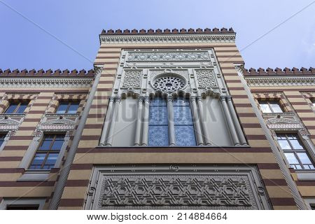 SARAJEVO, BOSNIA AND HERZEGOVINA - AUGUST 18 2017: Facade detail of Sarajevo city hall renovated after the war distruction