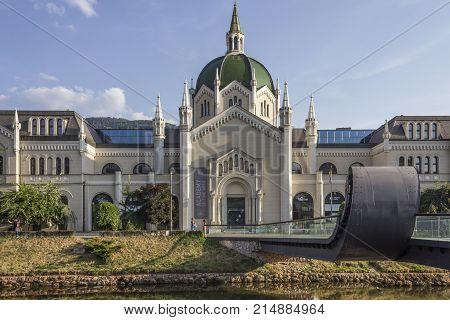 SARAJEVO, BOSNIA AND HERZEGOVINA - AUGUST 18 2017: Sarajevo Academy of Fine Arts building with its modern bridge called Festina Lente