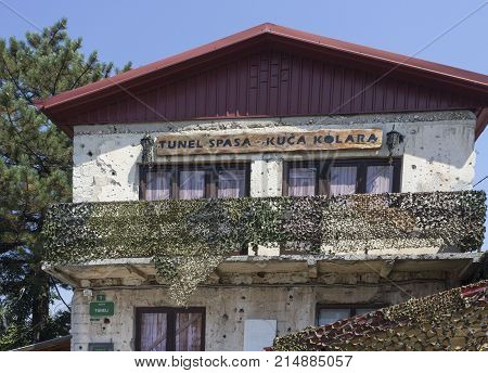 SARAJEVO, BOSNIA AND HERZEGOVINA - AUGUST 19 2017: Damaged facaded of the Tunnel Museum of Sarajevo constructed by the besieged citizens of Sarajevo during the war