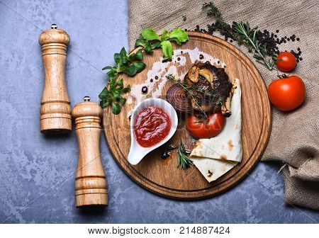 American Dish Served In Restaurant Or Steakhouse. Roasted Steak