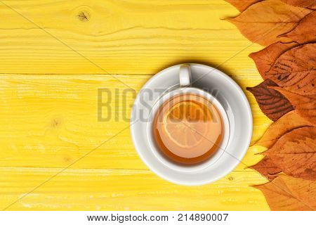 Tea Cup With Dry Leaves Making Autumn Composition