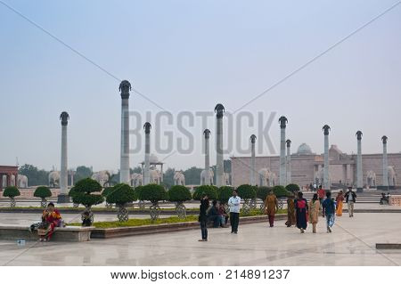 Lucknow, India - 16th Nov 2017: Families walking past the pillars and gardens of the famous Ambedkar park in lucknow. This is a popular hang out spot for locals and tourists alike
