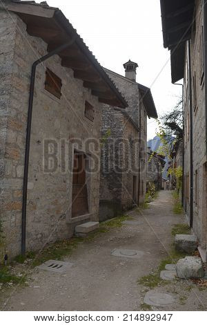 A small street in the hill village of Erto in Friuli Venezia Giulia north east Italy. The village is famous locally for having being evacuated following the 1963 Vajont Dam disaster.