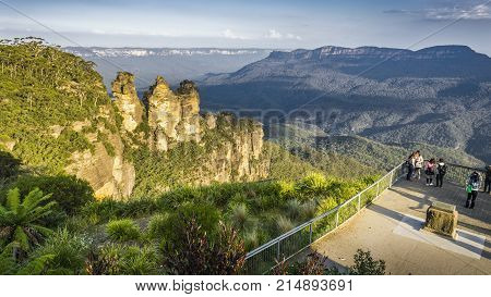 Sydney, Australia - Apr 18, 2017: Three Sisters rock formation at Echo Point. This wilderness area forms part of the Blue Mountains National Park. Image features the escarpment and Jamison Valley.