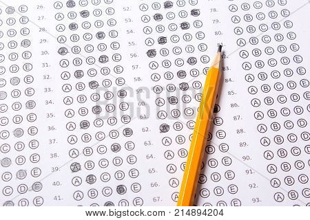 Blank multiple choice answer sheet filled with pencil