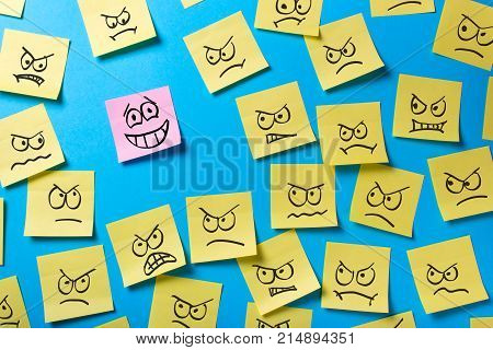 Unfinished tasks and goals. Office stickers with an angry face look at a smiling sticker