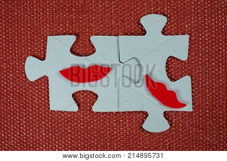 Close-up Of Two Parts Of A Puzzle. Symbolic Women With Lips. The Concept Of Psychological Compatibil