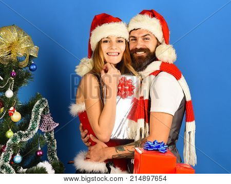 Man With Beard And Woman With Happy Faces On Blue