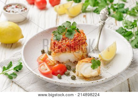 White fish (cod Pollock nototenia hake) braised with onions carrots and tomatoes. Vegetable marinade. Delicious hot or cold snacks for foodies. Selective focus