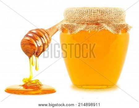 honey in a jar and dipper isolated on a white background
