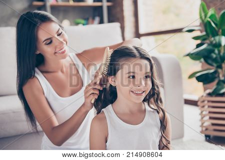 Close Up Photo Of Happy Smiling Schoolgirl With Curly Long Dark Hair And Her Beautiful Mum Who Is Br