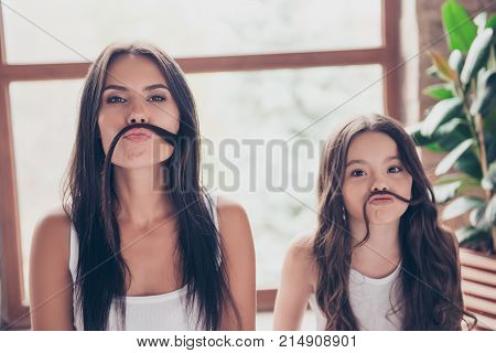 Cute Funny Sisters With Beautiful Long Hdark Hair Are Making Fake Mustache With Their Hair, They Are