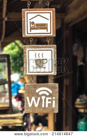 Wooden sign of wifi coffe and bedroom in thai country