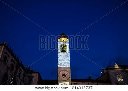 Clocktower with illuminated christmas decoration at night in Dubrovnik, Croatia, Europe