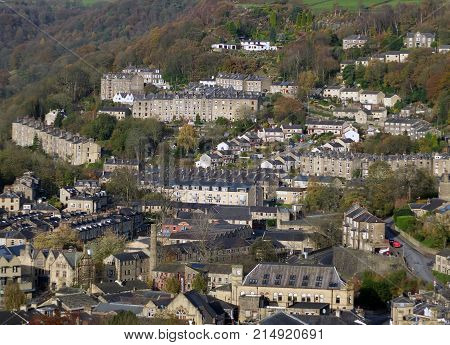 aerial view of hebden bridge showing streets mill chimneys and surrounding country