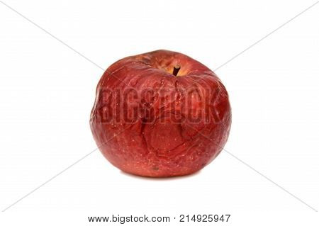 Red rotten apple on a white background, natural texture.
