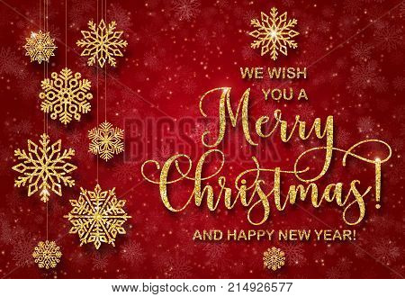 Greeting card with golden text on a red background. Glitter phrase We wish you a Merry Christmas and a Happy New Year Abstract Christmas tree shape. Golden snowflakes from shiny powder