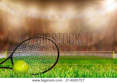 Low angle view of tennis racket and ball on grass court with deliberate shallow depth of field on brightly lit stadium background and copy space.