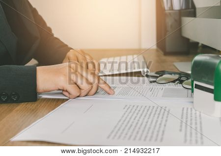 Close-up Businesswoman Reading And Checking Register Form Documents On Her Desk, Businiess Concept