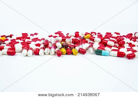 Selective focus of antibiotic capsules pills on white background. Drug resistance concept. Antibiotics drug use with reasonable and global healthcare concept.