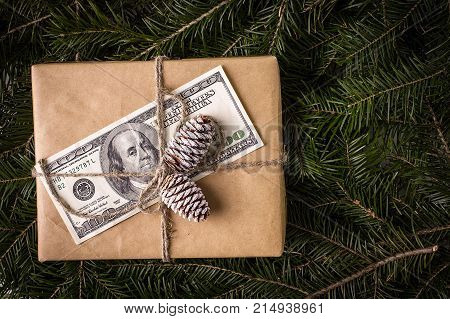 christmas gift box with banknote of dollar. Christmas and New Year concept