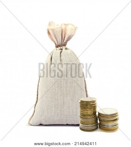 bag with money isolated on white background and two stacks of coins.