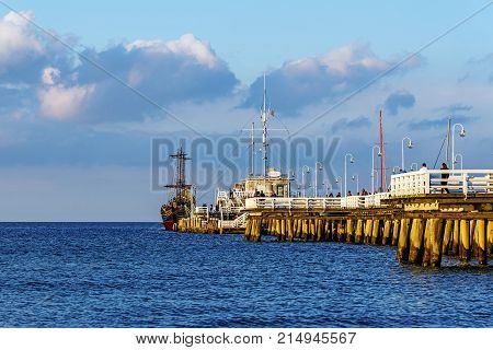 SOPOT, POLAND - JULY 8, 2017: The wooden pier in Sopot, Poland. Built in 1827, at 511m remains the longest wooden pier in Europe.