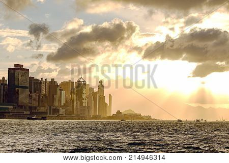 silhouette central Hong Kong and Victoria harbour at sunset in monotone with copy space