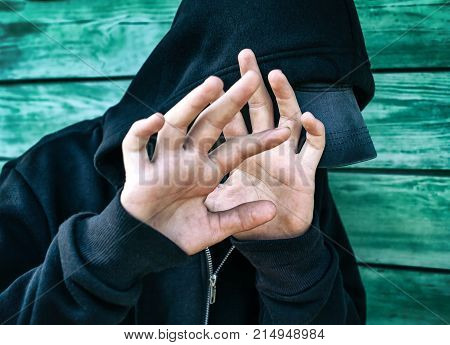 Frightened Person on the Wooden Wall Background
