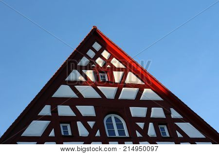 gable of a medieval half timbered house in sunlight