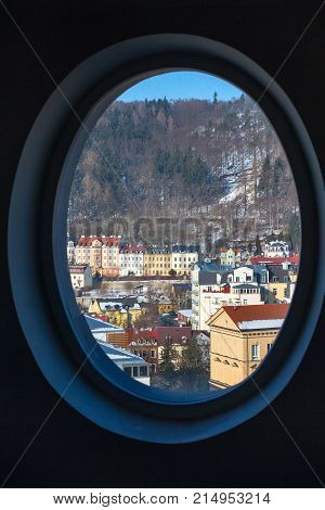 Karlovy Vary aerial panoramic famous spa town view through round window, Czech Republic