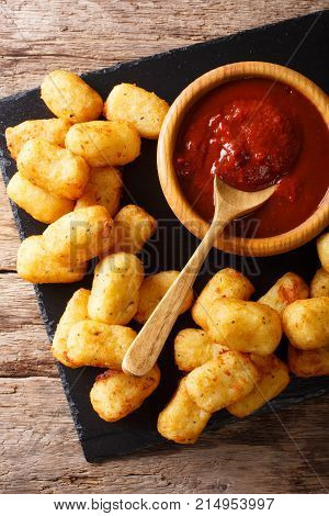 Homemade Tater Tots With Tomato Sauce Close Up. Vertical Top View