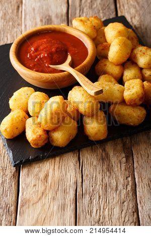 Fried Potato Tater Tots And Ketchup Close-up. Vertical