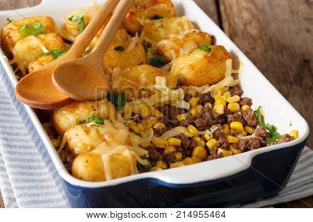 Homemade Casserole Of Tater Tots With Minced Beef, Corn And Cheese Close-up In A Baking Dish. Horizo