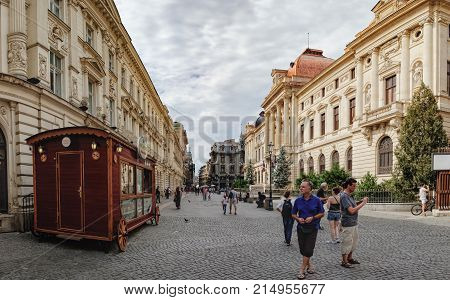 Bucharest, Romania - September 9, 2017: Panoramic view of walking tourists on the street of the historical center Lipscani Street - the Bucharest's liveliest entertainment district