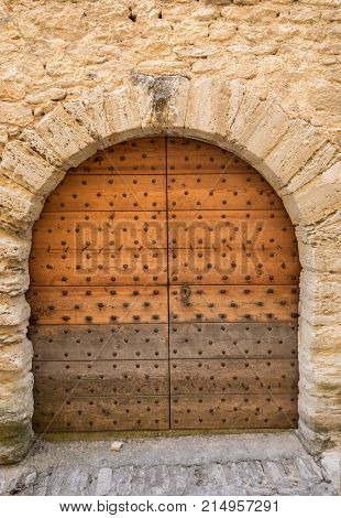 Old wooden door on stone house in Gordes. Provence France